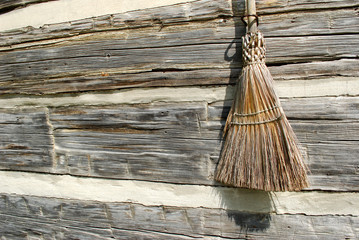Broom on wooden background