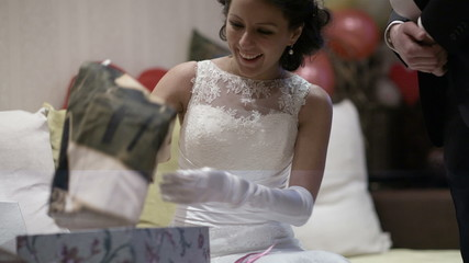 Bride opening wedding gift.