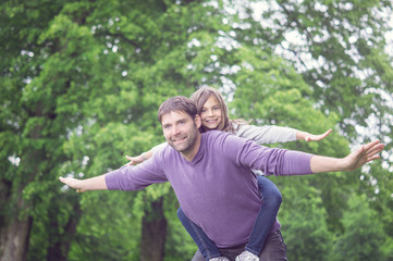 Father and Girl flying in the Park