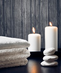 Spa massage border with towel stacked.candles and stone