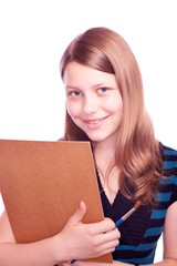 Teen girl holding paintbrush and paper