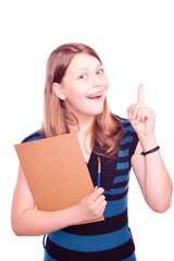 Teen girl holding paintbrush and paper and gesturing