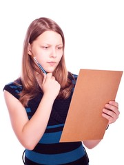 Teen girl looking at the paper