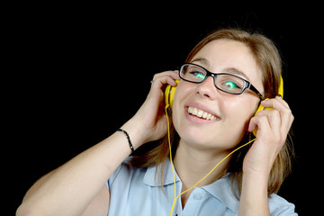 pretty woman listening to music with a headphone