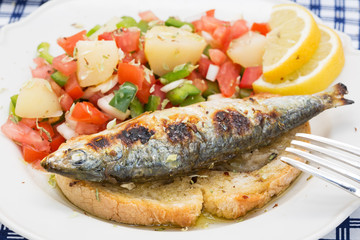Portuguese style grilled sardines with traditional salad