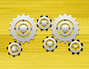 Gears on the wooden background