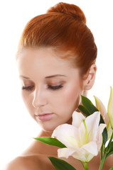 Beautiful girl with pink lilies on white background