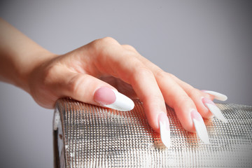 Close-up portrait of female hand with manicured fashion nails