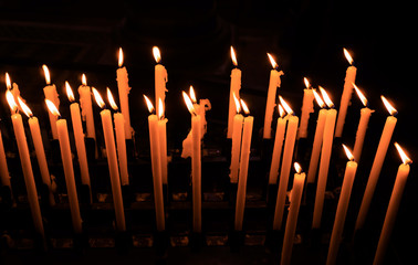 Church candle in a row.  Closeup of burning candle