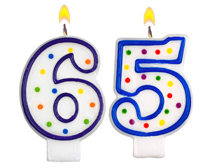 Birthday candles number sixty five isolated on white background