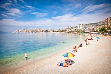 Tourists on pablic beach  in Saranda, Albania.