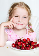 cute little girl eating cherries