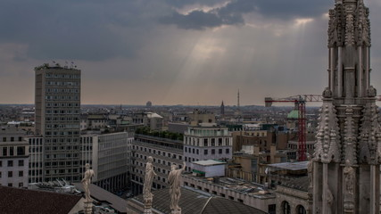 Milan skyline with sun rays time lapse 4K