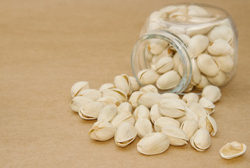 close up of a bottlel of pistachio nuts