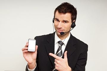 Handsome customer service operator shows on mobile phone