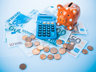 piggy bank and calculator.  Piggy bank with calculator and  mon