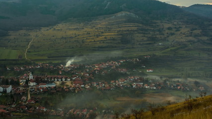 Transylvania, Romania, Remetea village covered in rolling  fog