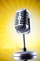 Retro microphone on summer sun grunge