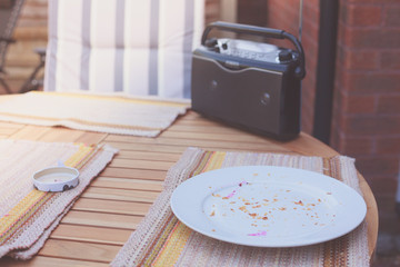 Radio and leftovers on table