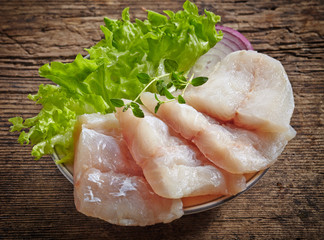 raw hake fish fillet pieces