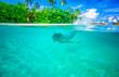 Swimming near tropical island
