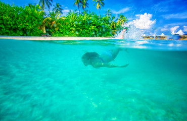 Swimming near tropical island