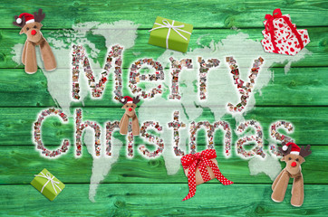 Merry christmas text - wooden background with red decoration