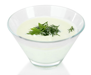 Cucumber yogurt in glass bowl, isolated on white