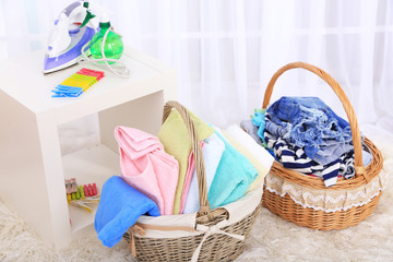 Colorful towels and clothes in baskets
