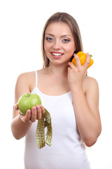 Beautiful girl with healthy food and measuring tape, isolated