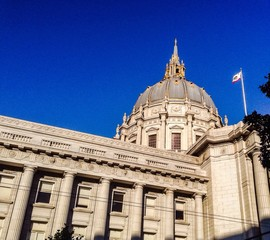 california flag and san francisco city hall