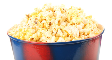 Popcorn in striped bucket isolated on white