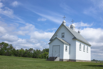 Little white church on the Prairie countryside.