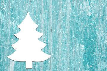 Weihnachtlichskarte - Hintergrund Holz türkis mit Tannenbaum