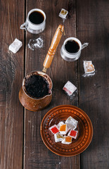 Turkish Delight and Turkish coffee over dark wooden background