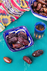 Date Palm and Middle Eastern tea over wooden background