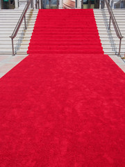 steps with red carpet