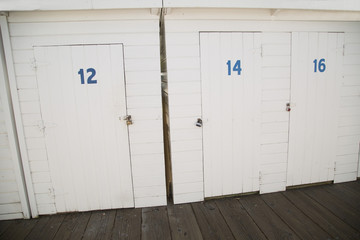 Painted white wood storage doors at boat dock