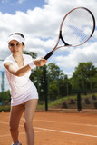 Woman playing tennis in summer poster