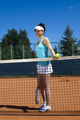 Woman playing tennis in summer
