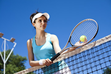 Girl playing tennis on the court