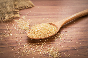 Brown sugar on wooden spoon