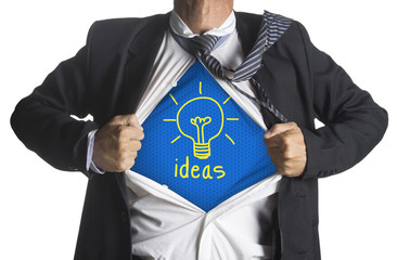 Businessman showing a superhero suit underneath idea light bulb