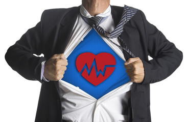 Businessman showing a superhero suit underneath heart beat symbo