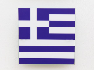 Greece flag on a plastic plate made in the form of decoration