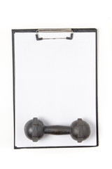 Blank notepad paper and pen and dumbbell, isolated on white back