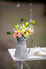 Beautiful white flowers in vintage watering