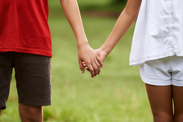 Children in love, boy and girl holding hands