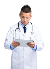 Asian male doctor look at digital tablet
