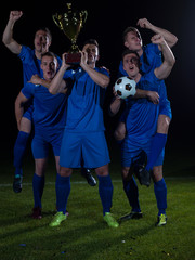 soccer players celebrating victory